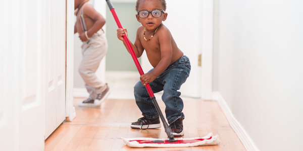 No Trolls, I'm not implying African American men are lazier than Whites. I like the photo and it highlights the need to get boys attuned to housework.